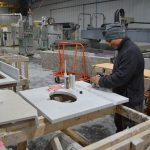 man working with granite