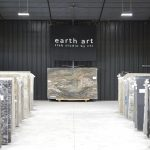 slabs of granite under earth art banner