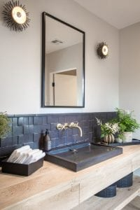 Beautiful black washplane sink on a wooden counter.